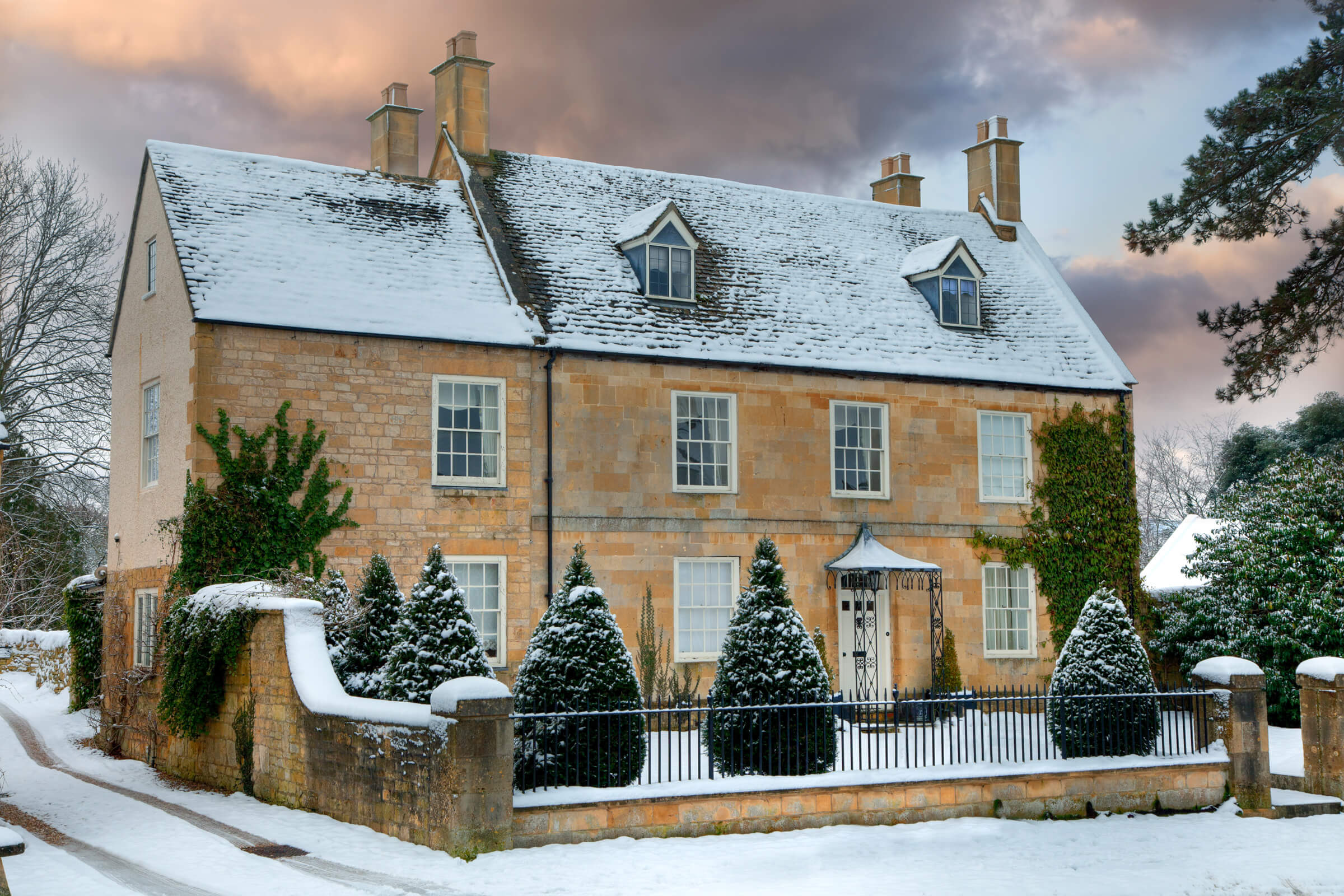 Conservation casement windows on a snowy cottage