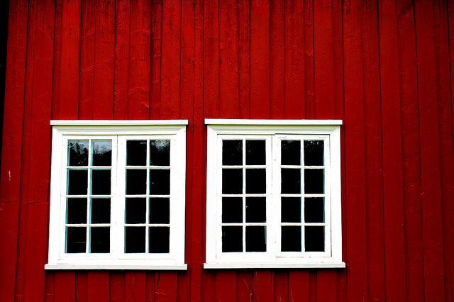 white wooden windows on red wooden house