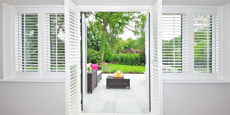 French doors with window shutters