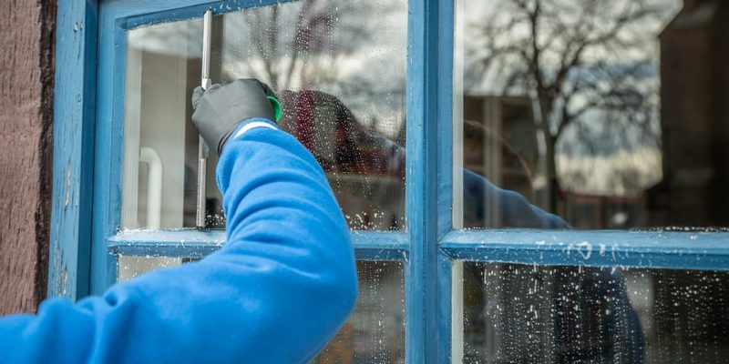 Cleaning a wooden window