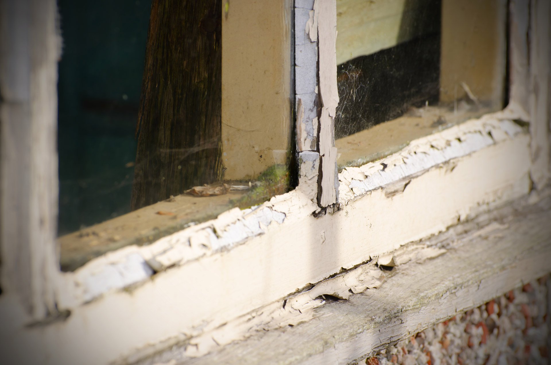 Old windows with peeling paint